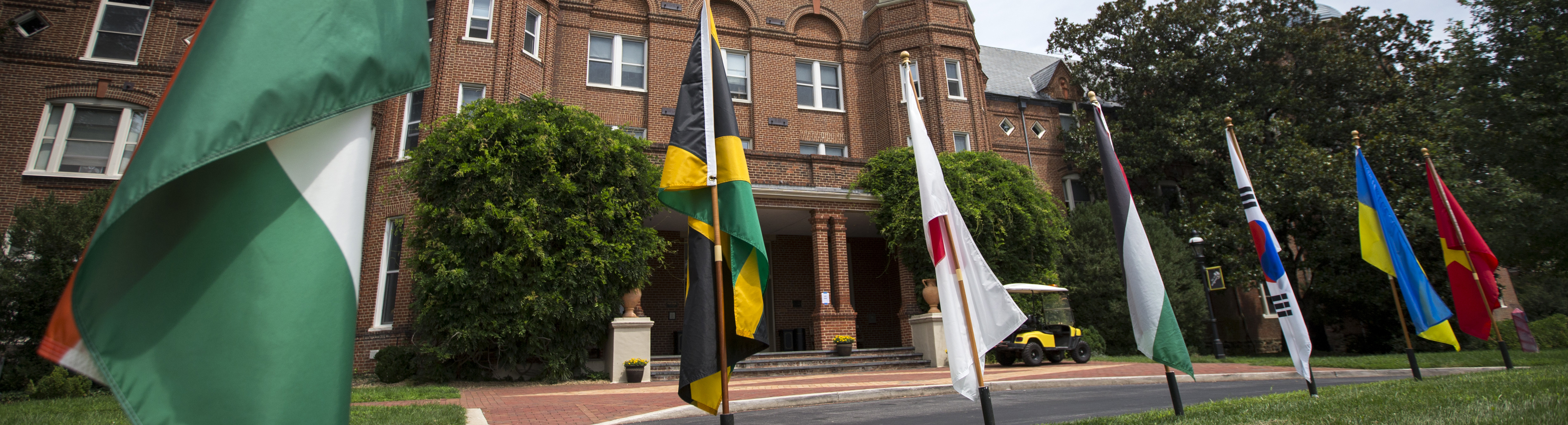 Photo of flags in front of Main Hall