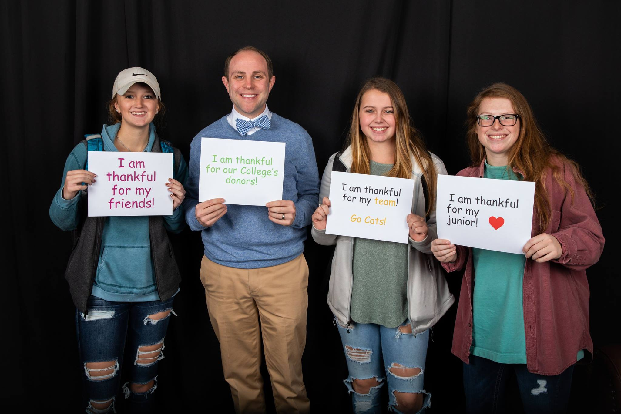 Wes Fugate, vice president for student affairs, and Randolph students express their gratitude at the Giving Tuesday photo booth