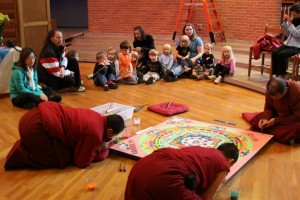 Randolph College Nursery School students watch the Buddhist monks working on the mandala.