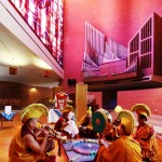 Buddhist monks build a sand mandala in the Houston Chapel at Randolph College.