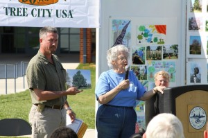 Marge Denham speaks about the deodar cedar tree at Randolph College, named the 2013 Heritage Tree, as Mark Gilbert shows a photo of the tree