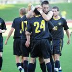 Photo of soccer team celebrating