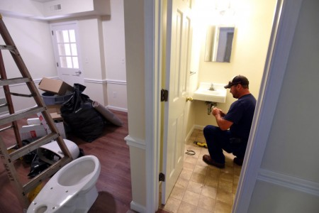 Buildings and Grounds staff member adds finishing touches to new apartments. (Photo courtesy of The News & Advance.