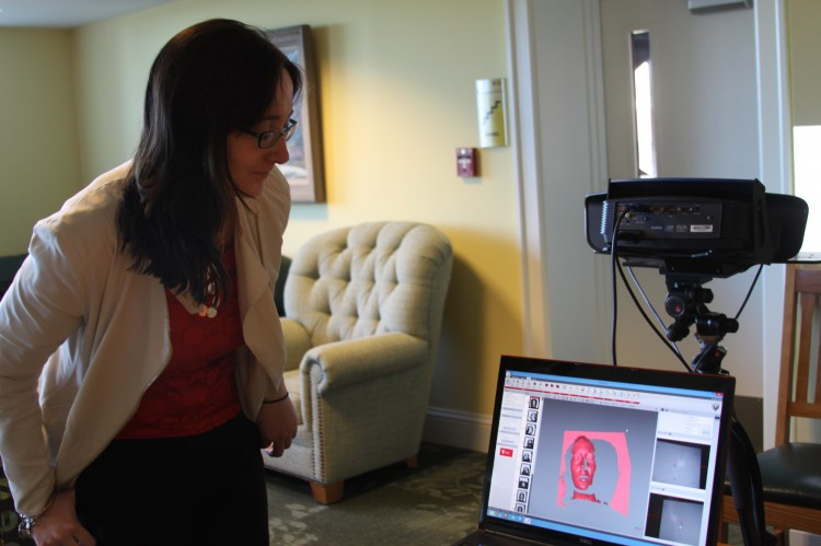 Megan Barrett '10, who is returning to Randolph to perform in the 2014 Greek Play, looks at the 3D scan of her head.