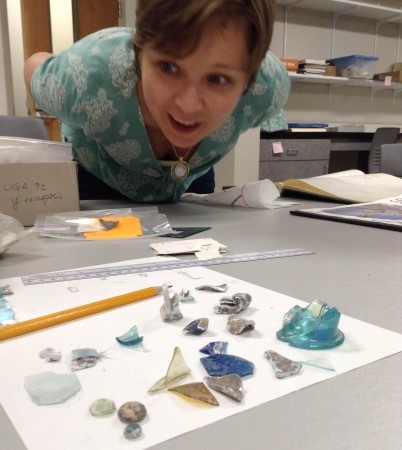 Allison-Sterrett-Krause '03, assistant professor of classics at the College of Charleston, examines specimens in her lab.