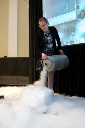 "Physicist Rebecca Thompson uses liquid nitrogen during her talk about the physics in the movie ""Frozen"" on Thursday evening."