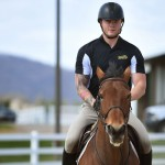 Michael Ramsey, a Navy veteran and member of the equestrian team at Randolph College, rides Koen during a training session at the Randolph College Riding Center.