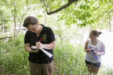 Environmental science professor Sarah Sojka records one of the testing sites near Percival's Island.