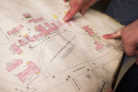 Strickler and Sherayko point to locations on an early campus map of Randolph-Macon Woman's College.