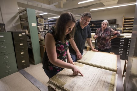 Samantha Strickler ''17 and history professor Gerry Sherayko look up property records from the early 1900s in the Jones Memorial Library.