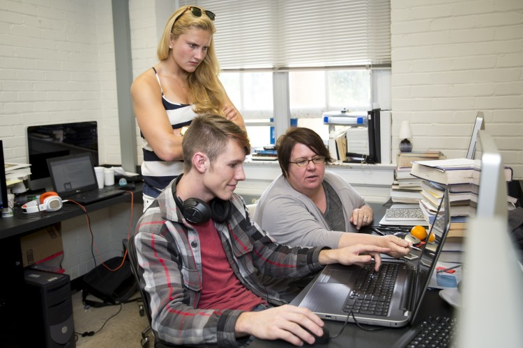 Physics Professor Katrin Schenk (right) assists Eric Huber '18 and Franziska Klostermyer '15 with a programming component of their project developing an ultrasonic vocalization research system.