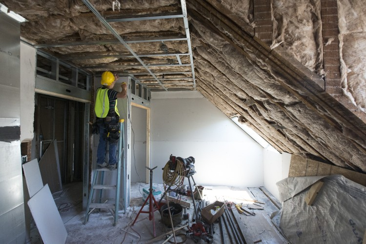 A worker frames new walls in a Wright Hall room that was completely remodeled.