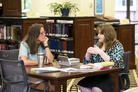 Sociology Professor Danielle Currier meets with student Ayla Hagen '18 about her research on an old mill in the Lynchburg area.