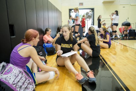 Emmy Roberts '18 spends time with high school volleyball players at the camp.