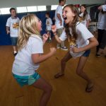 Erin Alburger, 11, (right) acts as part of an exercise in the