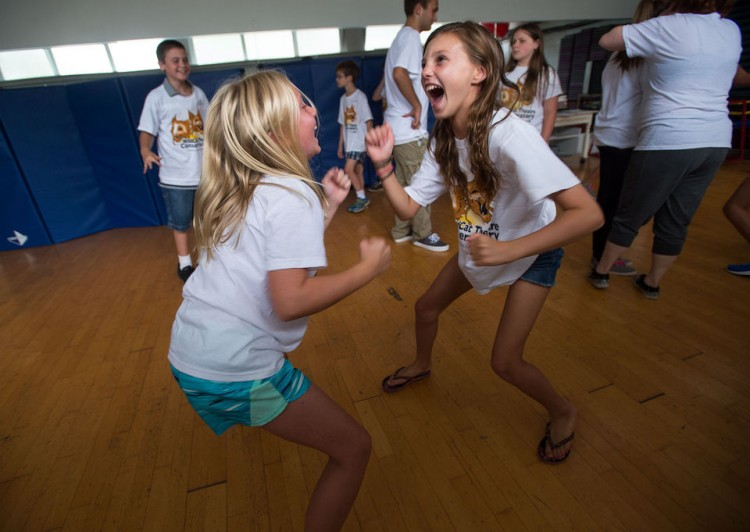 """Erin Alburger, 11, (right) acts as part of an exercise in the """"Clowning"""" class during Randolph's WildCat Theatre Conservatory in Lynchburg on Monday. (Photo by Autumn Parry)"""