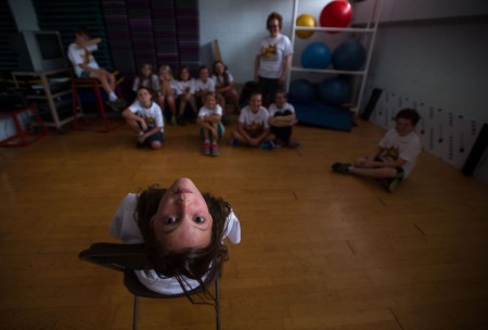 Erin Alburger, 11, participates in a staring exercise as the students learn how to become clowns during Randolph's WildCat Theatre Conservatory in Lynchburg on Monday. (Photo by Autumn Parry)
