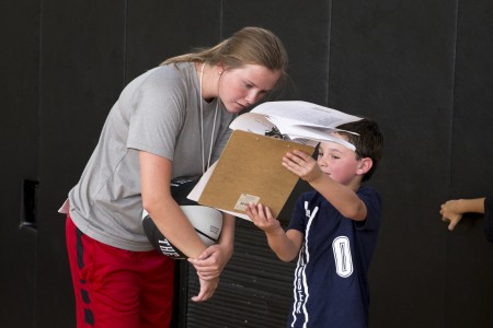 Brie Holdren '17 goes over notes with a camper.