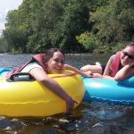 Photo of students tubing in the James River