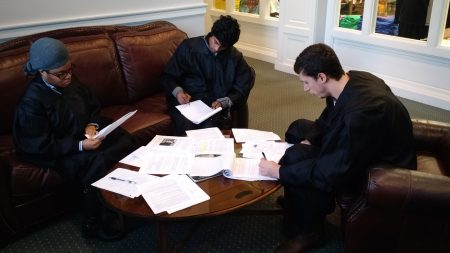 The judges study all the evidence before issuing their final ruling.