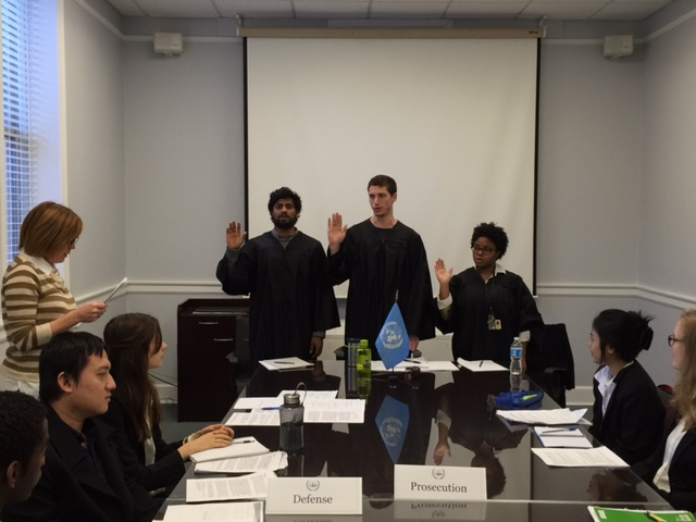Judges (from left) Tahan Menon '16, Donald Saltmash-Lubin '16, and Vanessa McBean '16 are sworn in on day one of the pre-trial.