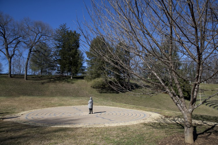 Alice Hilseweck Ball '61 takes a moment to reflect in the center of the labyrinth.