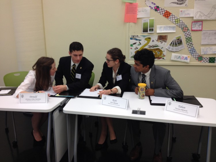 Members of the Randolph team deliberate their answer to a question at the Ethics Bowl.