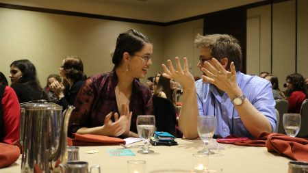 Lindsay Brents '16 reacts with English professor Gary Dop after winning an award for best fiction piece at the recent Sigma Tau Delta International Conference.