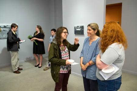 Friends and colleagues visit at Andrea Mewhinney's Senior Art Exhibit reception.