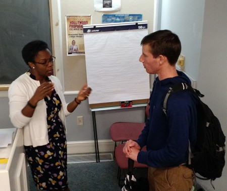 Tia Stokes-Brown '97 discusses politics and her research with a Randolph student following her presentation Thursday.