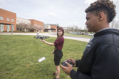Dyson Yuille, 14, prepares to fly a drone that is carrying a simulated sky crane, which teacher Caitlin Unterman is holding, during coursework on a mock mission to Mars on Thursday, April 21, 2016 in Forest, Va. The students are planning a simulated mission to Mars and are even getting help from NASA scientists. (Photo by Jay Westcott/The News & Advance)