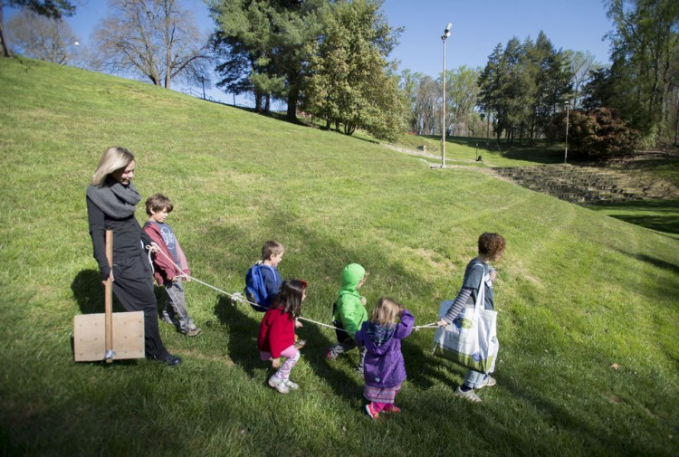 Students and teachers walk through Randolph College's campus on Wednesday to the organic garden. Photo by Jill Nance