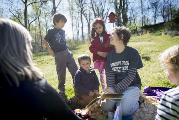 Teacher Shanna Jackson reads a book about praying mantises to the students of Randolph College Nursery School on Wednesday while in the organic garden on campus at Randolph College. Photo by Jill Nance