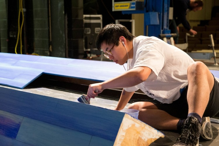 Sam Sun '17 paints part of the set for Hank Williams: Lost Highway, which will be performed in Thoresen Theatre later this year.