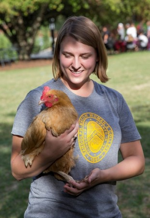 Sara Woodward '16 holds a chicken at last year's Involvement Fair.