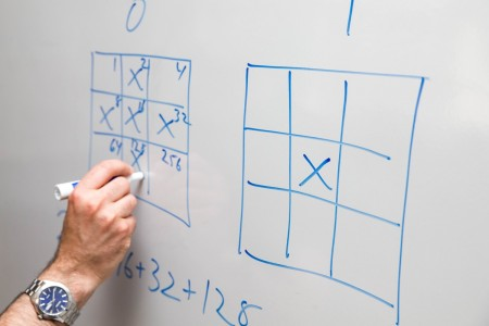 Mathematics professor Marc Ordower demonstrates the strategy of the game.