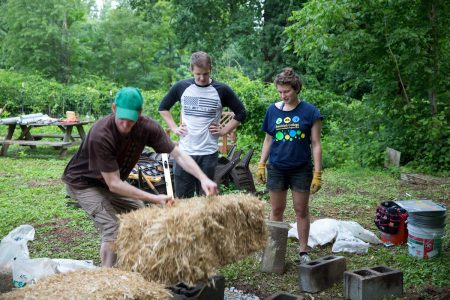 Randolph students are highly involved in the College's sustainable practices. Pictured is a workshop on strawbale construction led by Jessy Spencer '17 this summer.