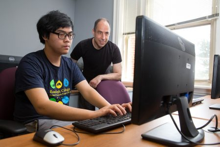 Anh Vo '18 ranked first in Virginia and 12th in the nation at a recent Virginia Tech Regional Mathematics Contest (VTRMC). Here, he is shown working with mathematics professor Marc Ordower on his 2016 Summer Research project to create a competitive, 3-D version of John Conway's Game of Life.