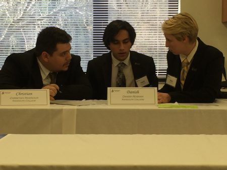 (From left) Christian Ridenour '18, Danish Roshan '18, and Katya Schwab '17 deliberate during the 2017 VFIC Ethics Bowl.