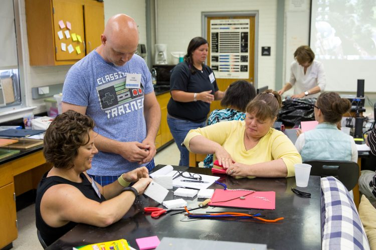 Participants in the 2016 Science Teaching Institute learn a creative way to teach earth science students about earthquakes.