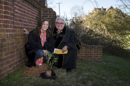 Erin McClelland '17 and President Bateman plant a rose on front campus, as is custom for the Founders' Day tradition.
