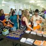 Volunteers assemble after-care kits in Smith Banquet Hall