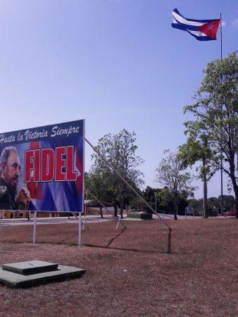 Cuban flag and Fidel Castro billboard