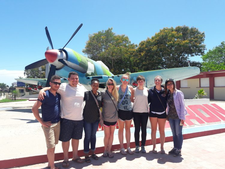 Randolph students in front of a classic Cuban airplane.