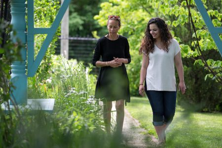 Shaun Spencer-Hester and Nour Elkhamra '17 walk through the Anne Spencer House Garden.