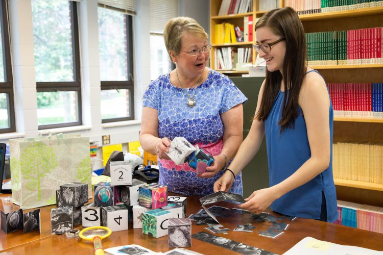 "Education professor Cheryl Lindeman and Jasmine Fowler '20 craft more blocks for their ""Curiosity Kit."""