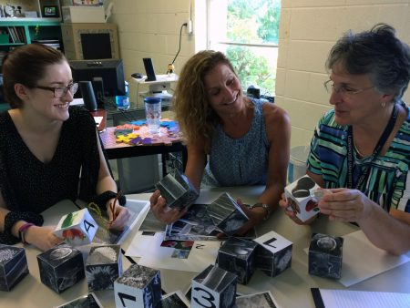"Jasmine Fowler '20 shows the ""Curiosity Kit"" to New Vistas School teachers Susan Royer '17 M.A.T. and Diane Roy."
