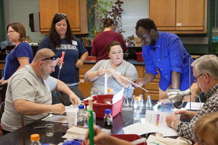 Igor Ngabo '18 assists teachers in an activity during Randolph's 2017 teaching institute,
