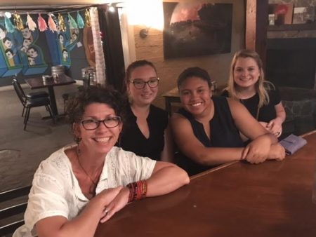 (From left) Maier education curator Laura McManus, office manager and public engagement coordinator Danni Schreffler, Stacey Samuels '18, and Maddie Shelby '18