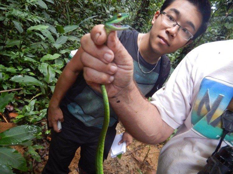 Student handling snake